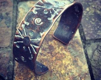 Copper Stamped Sunburst Cuff Bracelet with a Silver Shimmer Patina