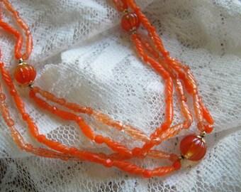 Vintage orange necklace / 52 inch orange plastic bead necklace / Hong Kong Funky mid century necklace