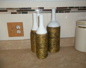 Decorative repurposed wine bottles.  In shades of green vintage cord. ONE of a KIND set