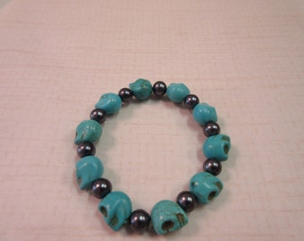 Turquoise and Silver beaded skull bracelet