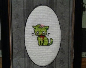 Halloween Zombie kitty cat cross stitch in custom matted frame.