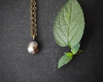 Old gold geo necklace. Faceted nugget delicate charm necklace in bronze and brass.