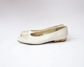 Vintage white leather woman shoes with golden studs