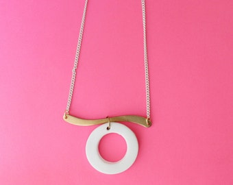Curved Bar Necklace on enameled white chain with white clay pendant.                  Simple Minimalist Necklace with a Charitable Donation.