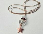 Necklace with lampwork beads and a antique copper tone star charm - transparent