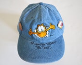 1980s Autographed Jim Davis Hat, Denim Garfield Baseball Cap with Two Garfield Pins Included
