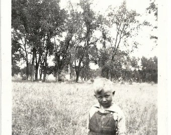 Old Photo Boy wearing Overalls standing in Field 1920s Photograph snapshot vintage