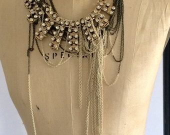 Vintage piece with hanging chains