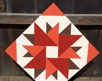 Hand painted rustic barn quilt. 1'x1', Double Aster pattern. Fall colors. Indoor/outdoor, weather resistant.