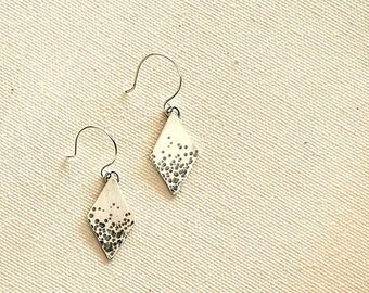 Silver diamond shaped earrings with hammered light and dark texture - Nebula Earrings