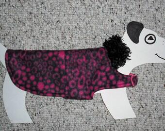 "Fleece Dog Coat, xx-small (5-7 lb) Pink & Black Animal Print with reversible pink microfleece lining. 13"" girth"