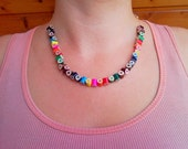 Rainbow necklace jewelry from rounded triangle shaped colored colorful...
