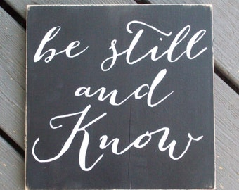 "handpainted ""Be Still and Know"" sign"