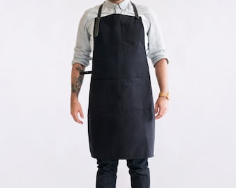 """Dahls"""" Black canvas apron. Cotton and leather. Handmade in Montreal, Canada"""