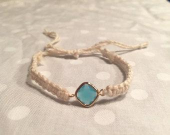 Aqua jewel in winter white cotton threading