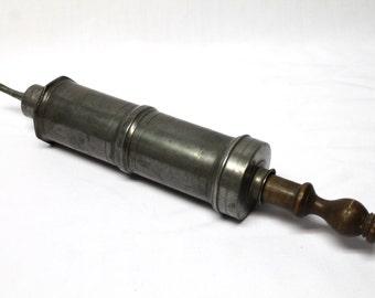 Antique mechanics grease pump gun metal industrial