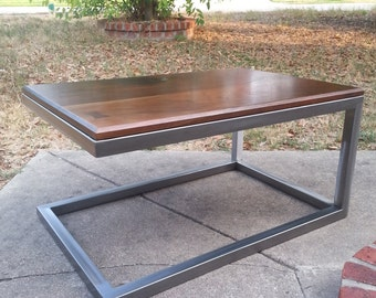 Cantilevered steel base coffee table with Peruvian walnut top