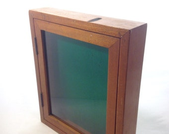 Hard wood table top cabinet with side shelves and glass door chestnut wood display case with glass door and green felt interior memorabilia shadow box artwork wall hanging yesteryears mid century planetlyrics Gallery