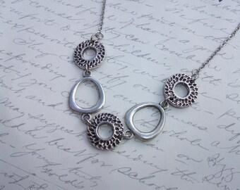 Modern hammered metal necklace