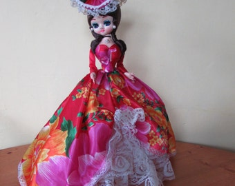Beautiful Vintage Big Eyed Doll On Stand.