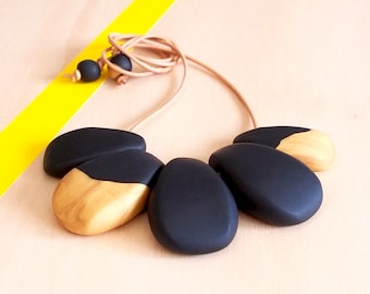 Handmade polymer clay bib necklace, on adjustable leather in black and gold