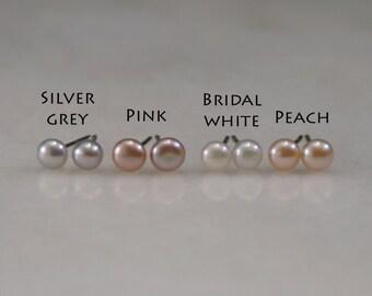 Freshwater Pearl stud earrings. Simple & Elegant. Choose Bridal white, Pink, Peach or Silver-Grey pearls. Sterling silver, 9ct or 18ct Gold.