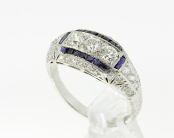 1920s Platinum Diamond Ring with Channel set Blue Sapphire Accents