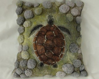 Turtle swimming over the reef, highly textured decorative cushion made from merino wool and nuno felt
