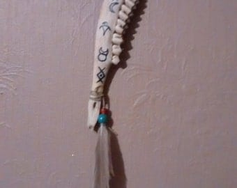 Deer jaw totem with pictograms