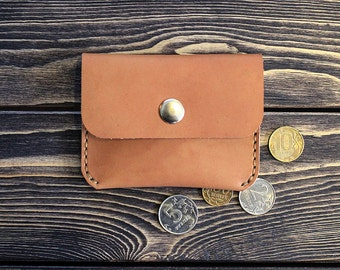 Small leather wallet for bills and coins