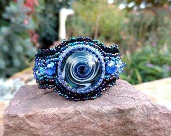 Blue chaos hand blown glass Native American inspired peyote beadwork bracelet by Ritacaldwell Beadworkdreamsraven