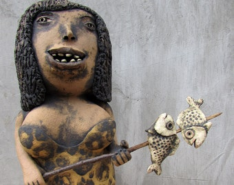 Ceramic cave woman with two fishes