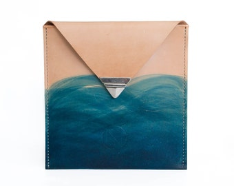 Handmade leather clutch belonging to the *DEEP BLUE SEA* collection