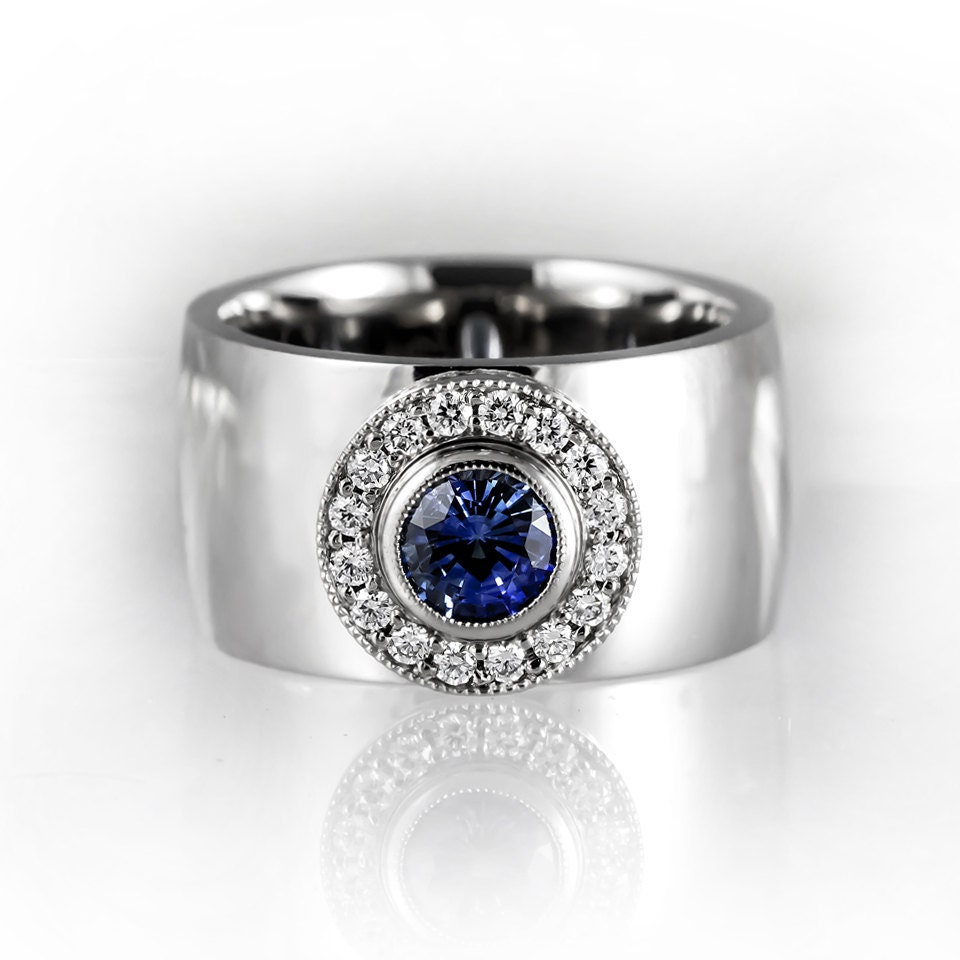 Blue sapphire halo engagement ring wide white gold engagement