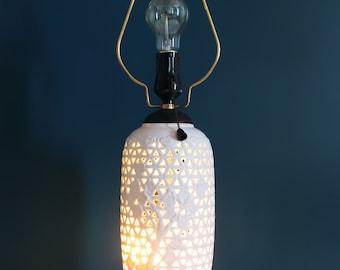 Porcelain Blanc de Chine pierced table lamp with wooden base, midcentury 50s.