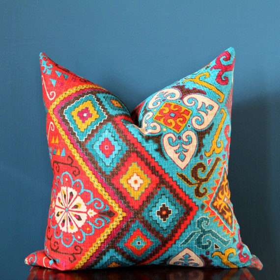 Two Colorful Cotton Cushion Covers with Geometric Embroidery Navya Khanna presents this trendy pair of cushion covers that are embroidered by hand in India. Vibrant stripes in a range of colors stand out brilliantly against the snow white cotton base.