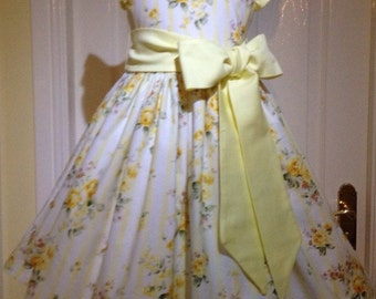 Girls lemon party dress, age 5, with removable sash and fully lined.