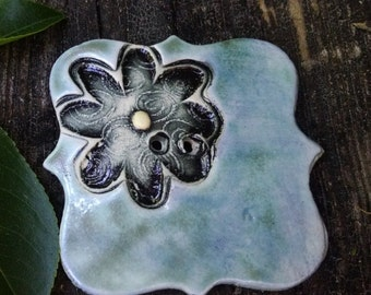 Blue square button with a flourish
