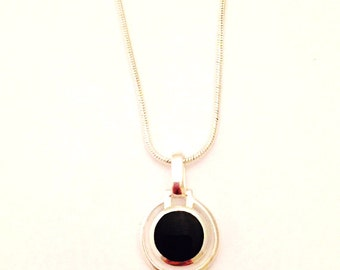 Black Onyx and Sterling Silver Pendant Necklace on a Sterling Silver Chain. Comes on your choice of either an 18 or 28 inch Chain