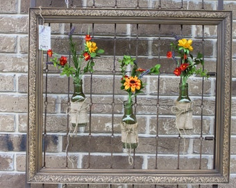 Brown Frame with Flowers in Bottles