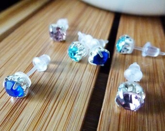 Lightly colored faceted stud earrings with plastic posts and soft rubber backs for sensitive ears