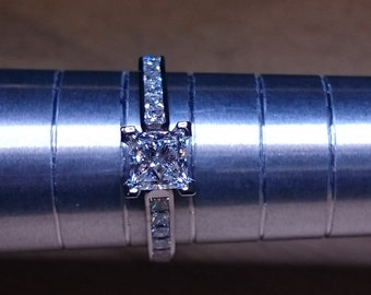 Platinum 0.60ct F VS2 GIA Certified Diamond Engagement Ring with 0.50ct square diamonds set in the shoulders. TDW 1.10ct. UK Handmade