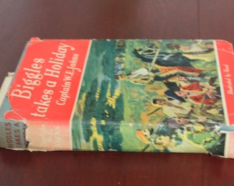 Biggles Takes a Holiday by Captain W.E. Johns. Illustrated by Stead. First Edition. Hardback book.