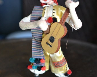 Klumpe Doll from 1950's, Spanish guitar player with original tags