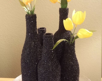 Stunning Textured Black Bottles Centerpiece