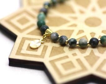 Green Ching Hai Jade Gemstones and Gold Wrist Tasbih | Miniature 33-bead Natural Stone Tasbih on Stretch Cord | Handmade by Azki