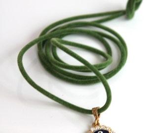 Swarovsky eye on green velvet cord- blue cord