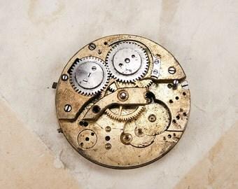 Rare antique brass pocket watch movement - c12