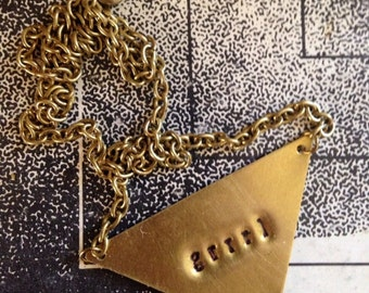 "Riot ""Grrrl"" brass pendant necklace"