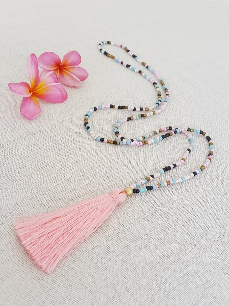 long glass bead tassel necklace with a pink tassel. Black Bedroom Furniture Sets. Home Design Ideas